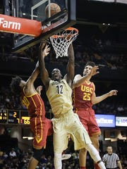 Vanderbilt center Djery Baptiste (12) shoots between