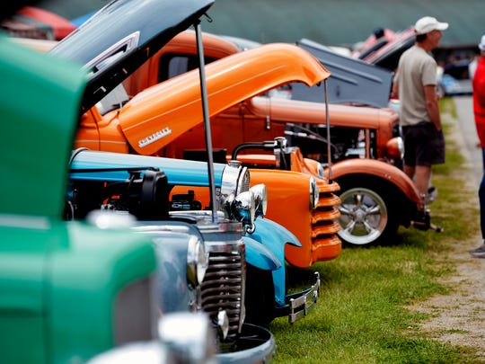 Street rods' engines are opened up for visitors to