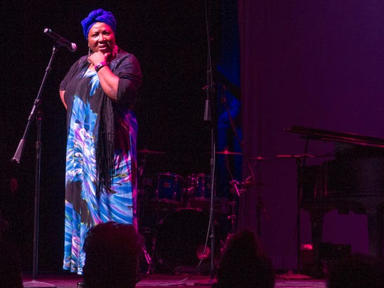 Sarah Addison tells the story of a slave ship unloading its cargo in America during the NAACP Celebration of Freedom, a multi-cultural concert held Friday, June 15, 2018, at the Rio Grande Theatre.