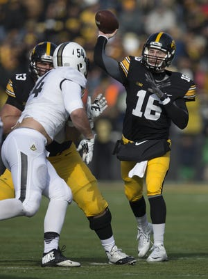 Iowa's C.J. Beathard throws ball during the Hawkeyes' 40-20 victory over Purdue.