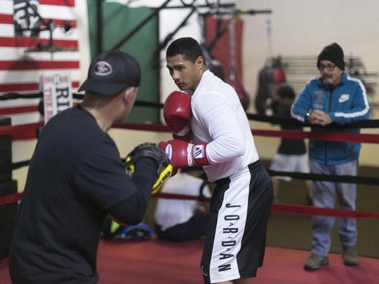 Rudy Puga Jr. works with Sal Lopez on the mitts as he prepares for his next fight on April 15 in Sacramento. | VERNON MCKNIGHT