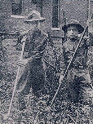 Troop 30 members Saul Ades and Louis Block are shown gardening in 1917 during World War I, after the troop was organized that year at the Young Men's Hebrew Association.