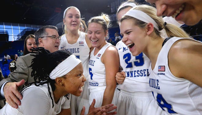 The MTSU women's basketball team, including clockwise from bottom left, Ty Petty, coach Rick Insell, Rebecca Reuter, Abbey Sissom, Gabby Lyon, Katie Collier and Alex Johnson, celebrates a win over Wake Forest in the WNIT last season.