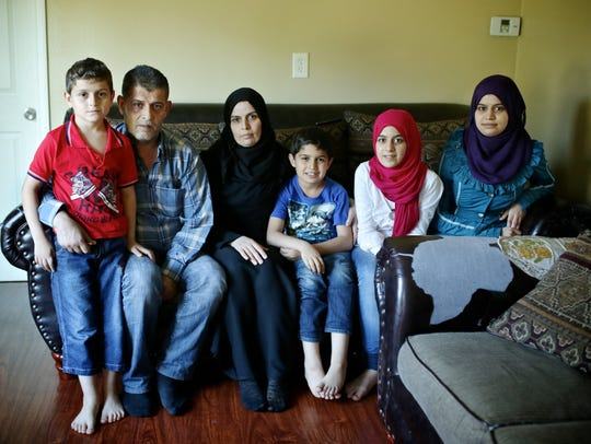 Syrian refugees (left to right) Mohmmod Assad, 8; Moustafa Assad, 48; Wafa Al Ahmad, 39; Liath Assad, 10; Shihd Assad, 14, and Riasha Assad, 19, are photographed in their home on Tuesday, Sept. 22, 2015, in Garden City. Originally from Idlib, Syria, the family fled to Istanbul, Turkey, because of the war and bombing there made it difficult to live in peace.
