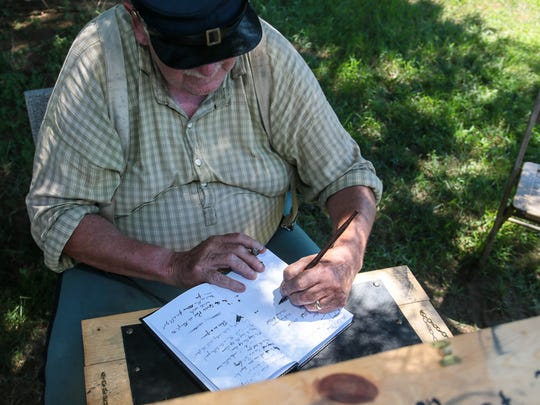 Mike Wood of Middletown, Delaware is the company clerk of the 61st New York Regiment of Civil War Soldiers at Brick Historical Society's Haven's Homestead Museum on August 7, 2016.