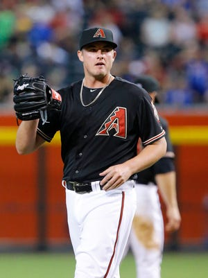 Arizona Diamondbacks relief pitcher Addison Reed reacts while pitching against the San Diego Padres on Saturday, June 20, 2015, in Phoenix.