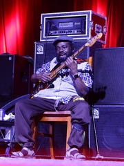 "Aston ""Family Man"" Barrett of The Wailers performs"