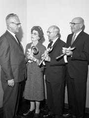 Robert Wick, Marie Case, Wilbur Holes, and Philip Halenbeck are shown at a building dedication ceremony Oct. 16, 1965, at St. Cloud State University. Campus buildings are named after all four.