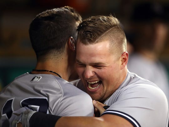 New York Yankees' Luke Voit, right, celebrates with Tyler Wade after hitting a home run off Oakland Athletics' Fernando Rodney during the eighth inning of a baseball game Tuesday, Sept. 4, 2018, in Oakland, Calif. (AP Photo/Ben Margot)
