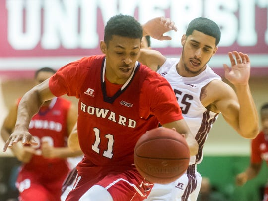 """UMES guard Thomas Rivera (2) defends Howard guard James """"J-Byrd"""" Daniel III (11) on Monday, Feb 1 at the William P. Hytche Athletic Center in Princess Anne."""