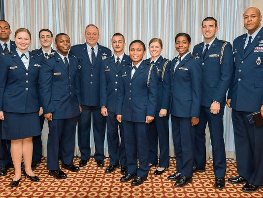 Air Force Chief of Staff Gen. Mark Welsh, fifth from left, poses with a group of  Reserve Officers Training Corps (ROTC) Cadets who will be commissioned through Howard University this Spring.  The future Air Force officers were present at the Air Force Association's Breakfast Series which was held outside of Washington D.C. on April 2.