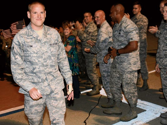 Airman 1st Class Spencer Stone, the Airman who helped foil a terrorist attack on a train in France Aug. 21, arrives at Travis Air Force Base, California, Sept. 3. Stone was greeted by hundreds of Airmen including Col. Joel Jackson, the 60th Air Mobility Wing commander, and Chief Master Sgt. Alan Boling, the 60th AMW command chief. He will receive continued medical treatment for his injuries at David Grant USAF Medical Center.