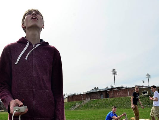 Spring Grove Area High School senior Wyatt Nace watches one of the Team America Rocketry Challenge (TARC) rockets launch on Wednesday. See more of the rocket team in a video at yorkdispatch.com.