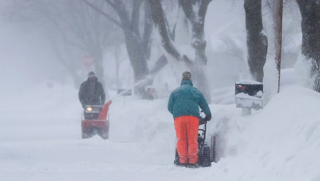 Many folks were using snow throwers, shovels to clear driveways, sidewalks during weekend.