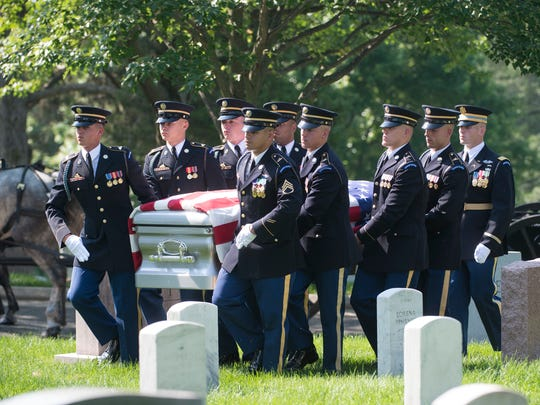 The casket of Stephanie Rader is carried June 1 during full military honors conducted by the Army's 3rd U.S. Infantry Regiment at Arlington National Cemetery in Arlington, Virginia.