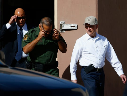 U.S. Attorney General Jeff Sessions (right) tours the
