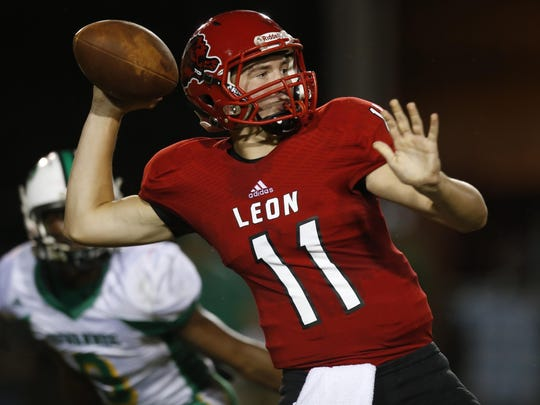 Leon quarterback John Carey makes a passing attempt during the Lions' 10-7 win over Suwannee on Friday night.