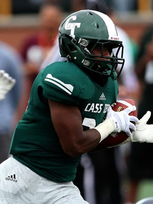Detroit Cass Tech's Tim Cheatem runs for a touchdown against Southfield during the first half Saturday at Wayne State.