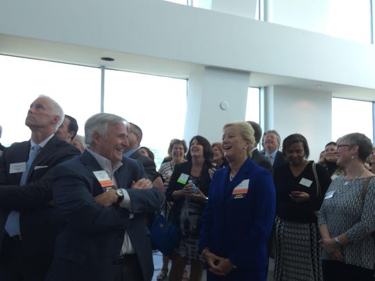 Bill Butler, chairman of Corporex Companies, and Kay Geiger, regional president of PNC Bank, share a laugh during the unveiling of Vision 2015's new name and strategic plan on June 4 at The Ascent at Roebling's Bridge. Consistent with the theme of the new name, Skyward, attendees looked up to watch those speaking from the balcony at The Pinnacle Penthouse at The Ascent.