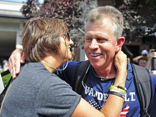 Vanderbilt baseball coach Tim Corbin gets a hug from his wife, Maggie, as the team leaves Tuesday for TD Ameritrade Park in Omaha, Neb., to compete in the College World Series. The Corbins started dating in the mid-1990s and have been married for 10 years.