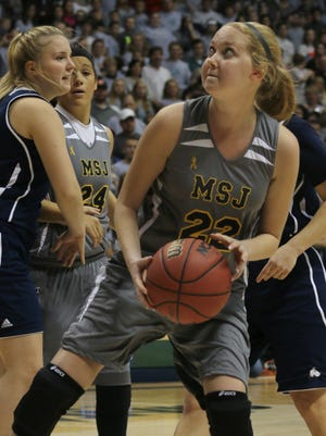 Mount St. Joseph's Lauren Hill catches a pass and prepares to shoot during her first NCAA college basketball game against Hiram University at Xavier University in Cincinnati on Sunday Nov 2, 2014. The NCAA allowed Mount St. Joseph's season opener to be moved up to Nov. 2, so that Hill, who has an inoperable brain tumor, to be able to play in a college basketball game. (AP Photo/Tom Uhlman)