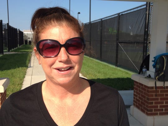 Kara Jensen, a physical education teacher at Wicomico Middle School in Salisbury, at a tennis skills session at Salisbury University tennis courts on Oct. 9, 2015.