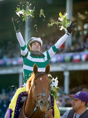 Joel Rosario celebrates after riding Accelerate to victory in the Breeders' Cup Classic horse on Nov. 3, 2018.