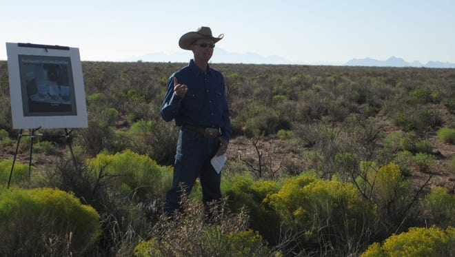 Las Cruces District Rangeland Management Specialist Lane Hauser explains the monitoring and evaluation process the BLM conducts before, during and after the restoration treatments during a field trip.