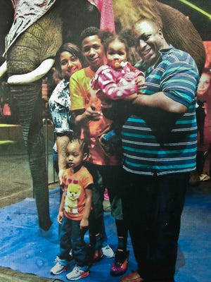 Eric Garner, right, poses with his children in a family photo.