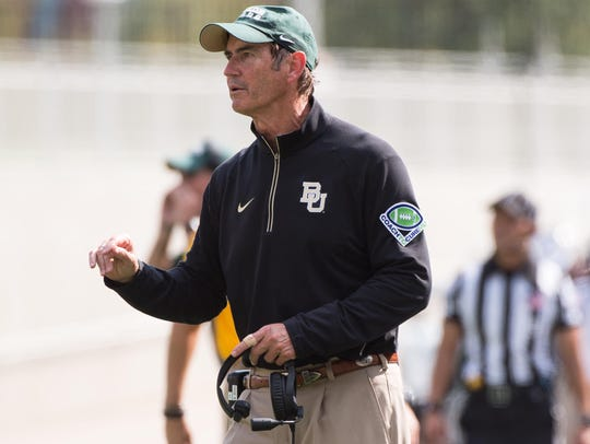 Baylor coach Art Briles talks to his team during a