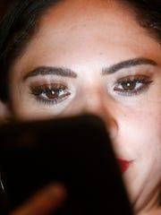 Valerie Ponzio, of El Paso, Texas looks up at the screens