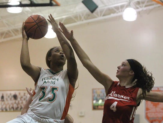 FAMU DRS senior Dominique Jeffery drives for a basket
