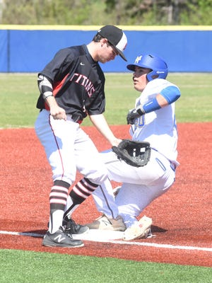 Mountain Home's Will Gross slides safely into third base during the Bombers' 6-0 win over Jacksonville on Saturday.