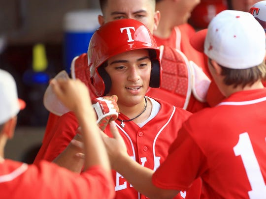 Ray's Ronald Vasquez celebrates with teammates after scoring against Calallen during game 1 of Class 5A regional quarter finals series on Thursday, May 18, 2017, at Whataburger Field in Corpus Christi.