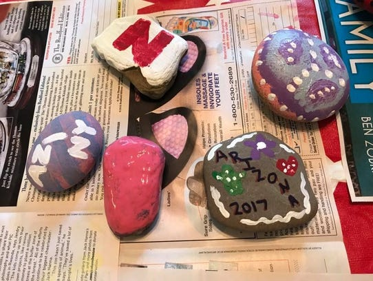 Some of the rocks made by Tracy Stewart's family before