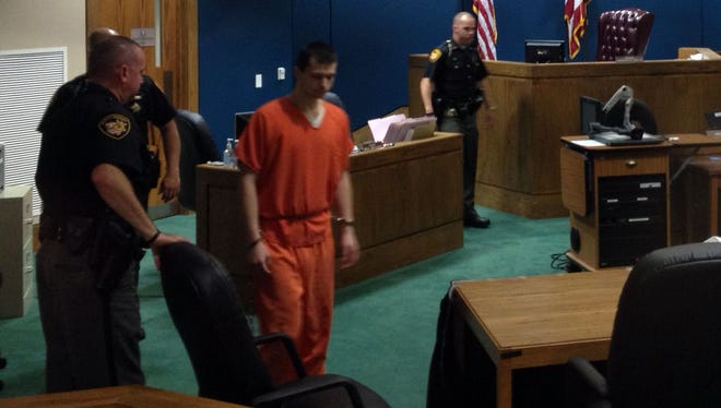 Deputies lead Austin Myers into his sentencing hearing in Warren County Common Pleas Court on Thursday.