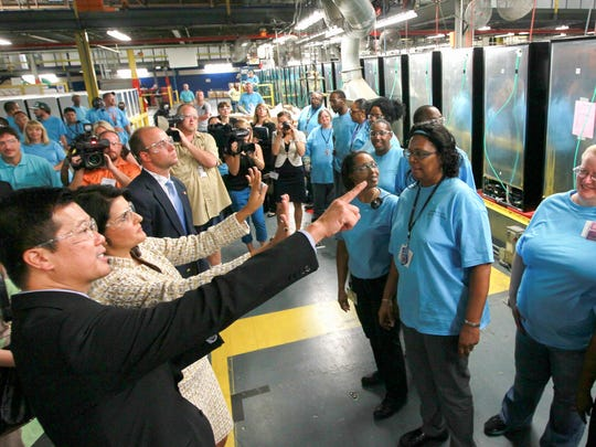 FILE: In 2012, Jack Truong, (former) Electrolux major appliances North America president and CEO, and (former) South Carolina Gov. Nikki Haley tour the assembly line and greet workers at the refrigerator plant in Anderson.