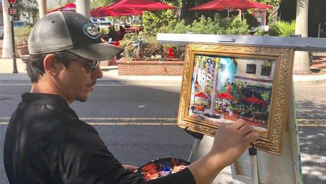 Street artist Lazaro Morera paints the scene at Clasico's intriguing corner.