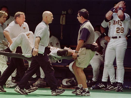 Pittsburgh Pirates Al Martin, right, reacts as teammate