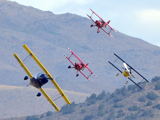 Biplanes on the course during a heat race during the Reno National Championship Air Races on Sept. 12, 2013.