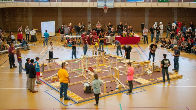 "Middle and high school students participate Saturday in the NM BEST Robotics Competition at NMSU's James B. Delamater Activity Center. The theme of the competition was mining and robots were designed to navigate a field, much like an obstacle course, and collect different ""minerals."""