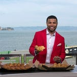 Detroit Lions wide receiver Golden Tate pitches for Pizza Hut on Feb. 4, 2016.