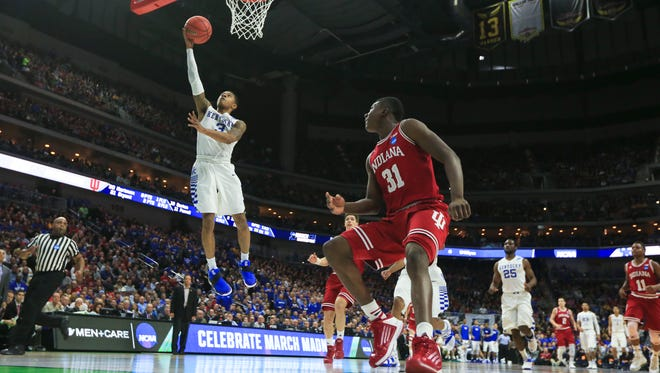 Tyler Ulis scores against Indiana in the first half.