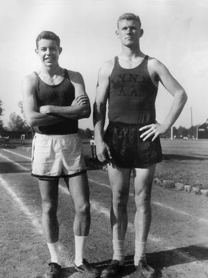 Mike Cody (left) and Robert Jackson were the top point scorers during the 1957 track season and anchored the Southwestern track team in the Spring of 1958. Cody ran the middle-distance and distance events and Jackson was the field man, who threw the discus, javelin and shot put as well as high jump. The two were preparing for the upcoming season on March 13, 1958, Cody's 22nd birthday.