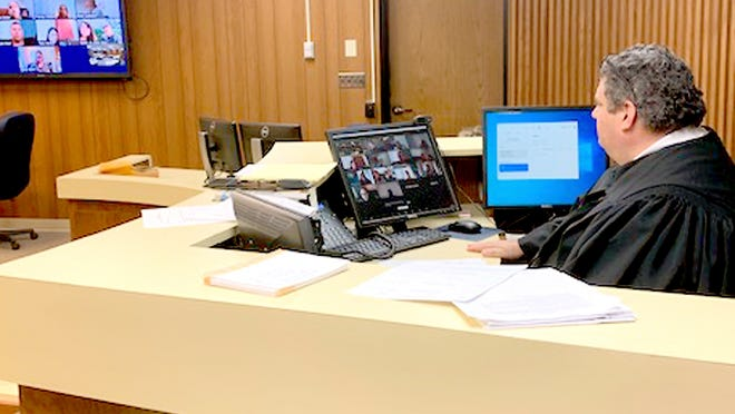 St. Joseph County Circuit Court Judge Paul Stutesman conducts adult drug treatment court via Zoom. Stutesman said day-to-day work at the courthouse the past three months has been far from normal.