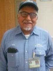 Camino Real Regional Utility Authority employee Raul DeLaCruz. CRRUA employees wear uniforms bearing the CRRUA logo, as well as a badge with the employee's photo and name, that is issued by Doña Ana County.