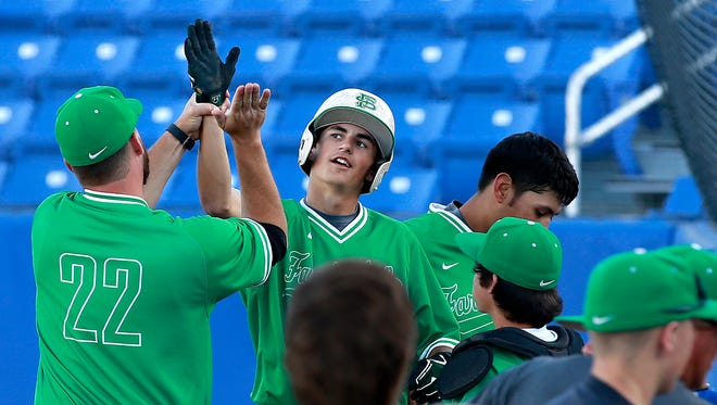 Farmington's Keaton Christy is congratulated by the Scorps during the game against Gallup on Thursday at Ricketts Park.