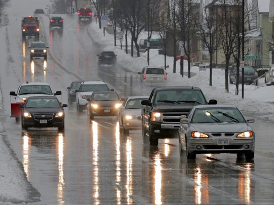 Drivers endures wet conditions following snow on Tuesday,
