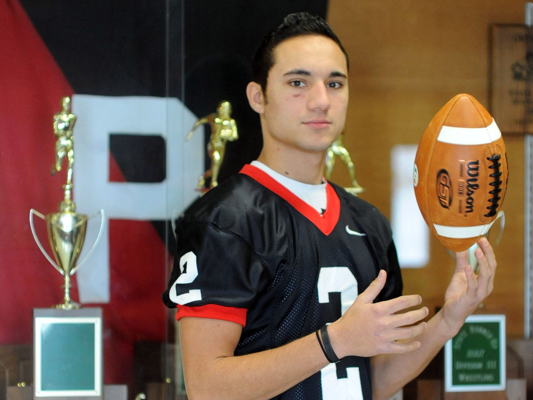 Pleasant High School senior football player Ryan Maniaci, who set a pair of school passing records this season, is the Fahey Bank Male Athlete of the Month for November.