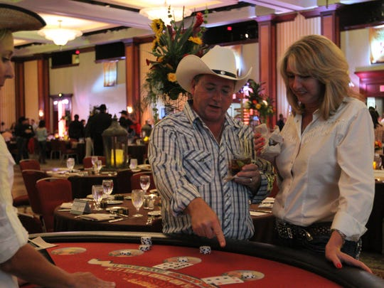 Wanna-be cowboys play poker, roulette and other games